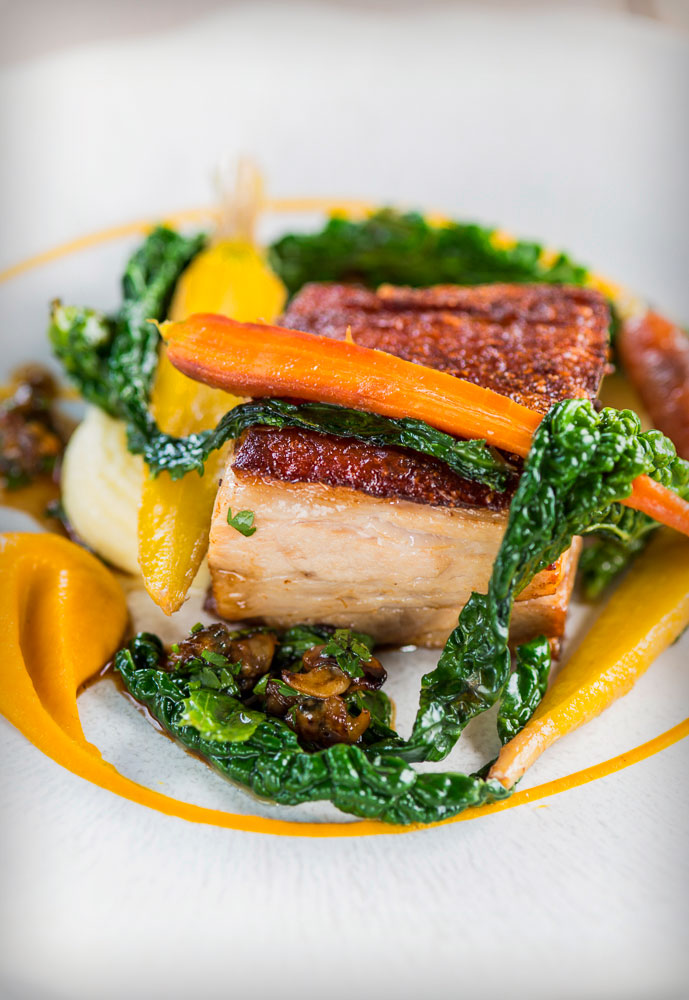 crispy pork belly, pickled cockles, carrot and cavolo nero